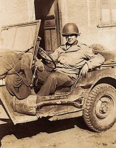 Sergeant Sorgee sitting in Jeep
