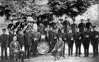 The Haynes Band's 26 uniformed members with their instruments.