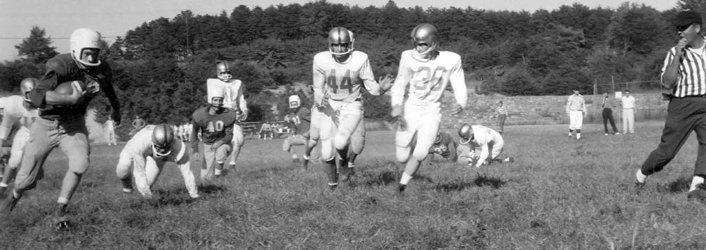 An action photo of a 6-man football game at Cliffside High in gthe 1950s.