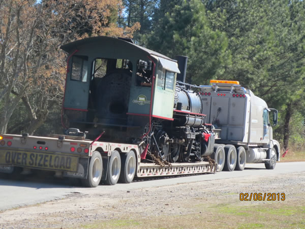 """The rig is seen from the rear. Sign on the back of the trailer: 'Oversize Load."""" Indeed."""