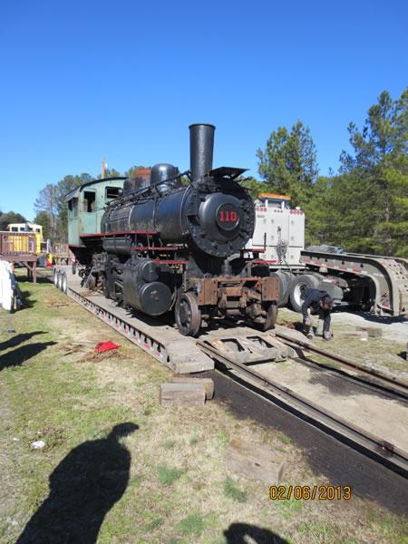 Workmen adjusting the rails.