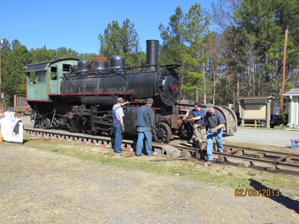 Workmen making more adjustments for the rolloff from the trailer.