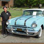 Ashley Reid and a restored 1950s Pontiac.