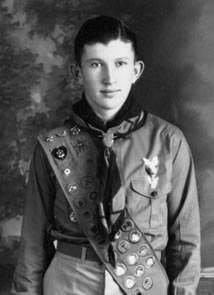 Grover in scout uniform wearing his new Eagle Scout sash