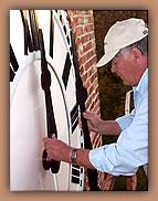 Man adjusting clock hands