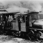 Old-timey train packed with passengers about to leave for the 3-mile run