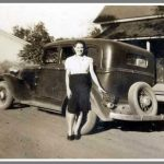 Attractive lady stands by a 1930s-ear car.