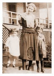 Lady of the early 1930s with here two young children on the steps of a Cliffside home.