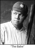Babe Ruth posing with a bat and wearing a New York Yankees uniform.