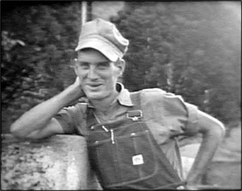 Fred Scruggs in his work attire: Overalls!