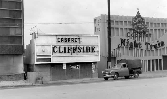 A street scene in Okinawa showing fronts of two adjacent 'cabarets.'  One bears the name 'Cabaret Cliffside.'