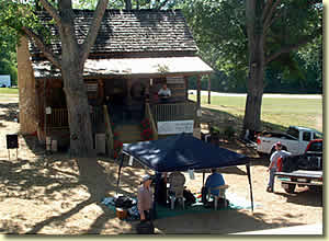 The old cabin, now restored and remodeled, has been moved to a spot behind the Swing's new residence.