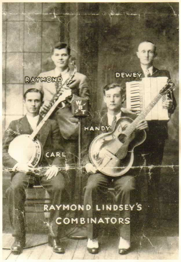 A promotional photo from station WBT in Charlotte of one of their featured music groups. This particular group included four instruments. a guitar, banjo, saxophone and an accordion. The photo is labeled 'Raymond Lindsey's Combinators,' and each musician is tagged with his first name: Handy, Carl, Raymond and Dewey.
