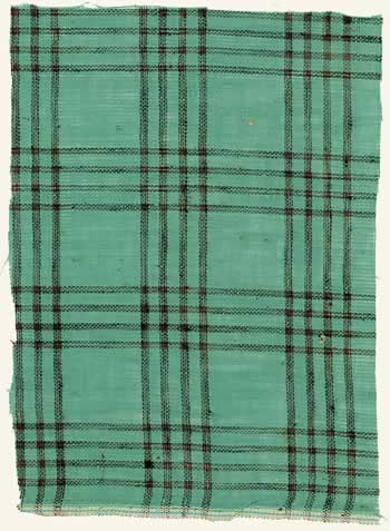 A bluish-green cloth with horizontal and vertical stripes creating the large traditional gingham plaid.