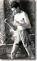 Jack, wearing ring attire, poses in boxing stance