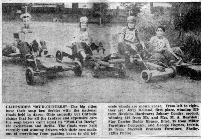 A clipping from the Shelby Star with a photo showing four racers seated on their homemade cars, made out of everything from packing boxes to old tricycle wheels. They are Jerry Holland, 1st place winner of $20; second place winner, Johnny Condrey ($10);  Buddy Houser was third ($5); and in fourth place was George Haynes, also $5.