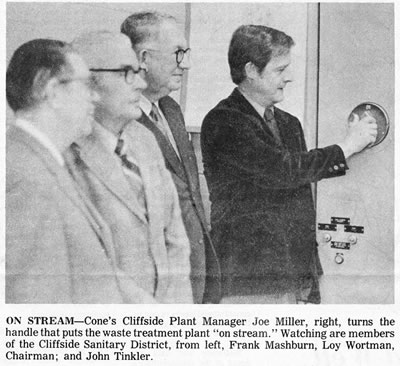 """On stream – Cone's cliffside plant manager, Joe Mller, right turns the handle  that puts the waste treatment plant """"in stream"""". Watching are members of  the cliffside sanitary district, from left, Frank mashburn, Loy Wortman, Chairman and John Tinkler."""