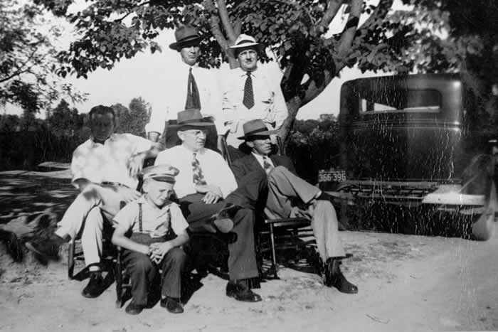 Five men and a boy in the yard, enjoying the summer day.