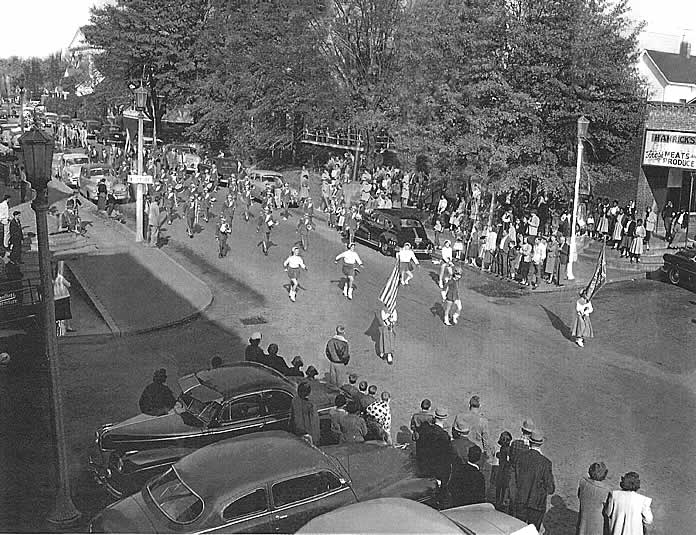 Led by the color guard, the majorettes  then the Cliffside School band, the parade enter 'downtown' Cliffside. A scant crow line the sidewalk and yard in front of Hamrick's grocery.