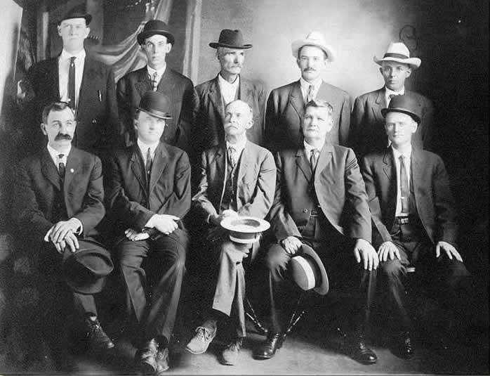 Ten solemn, all-business mill men seated around their beloved boss, Raleigh Haynes.