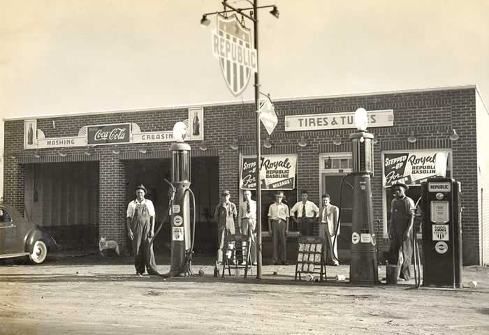 """An old fashioned """"full service"""" station. Built of brick, it has two bays for washing and """"greasing"""" and space for a small store."""