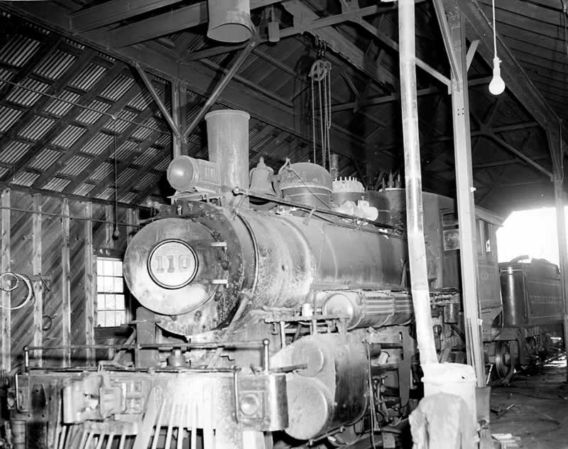 A view of engine 110 and its tender inside the big shed.