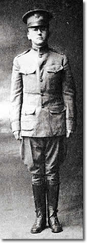 Rush standing at attention in WWI officer's uniform.