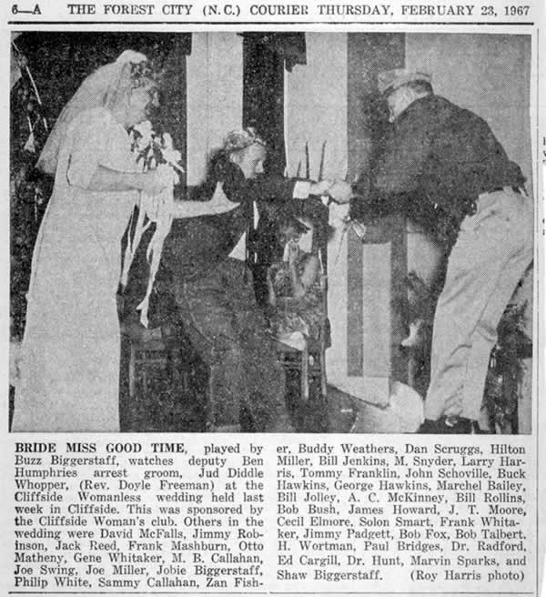 Photograph of the bride, Miss Good Time, played by Buzz Biggerstaff, watching deputy Ben Humphries arrest the 'groom', Jud Diddle Whopper (Rev. Doyle Freeman) at the Cliffside Womanless Wedding held in February, 1967. The caption lists the names of many others in the cast.